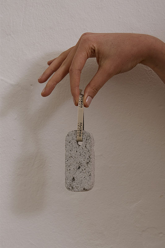 person holding pumice stone
