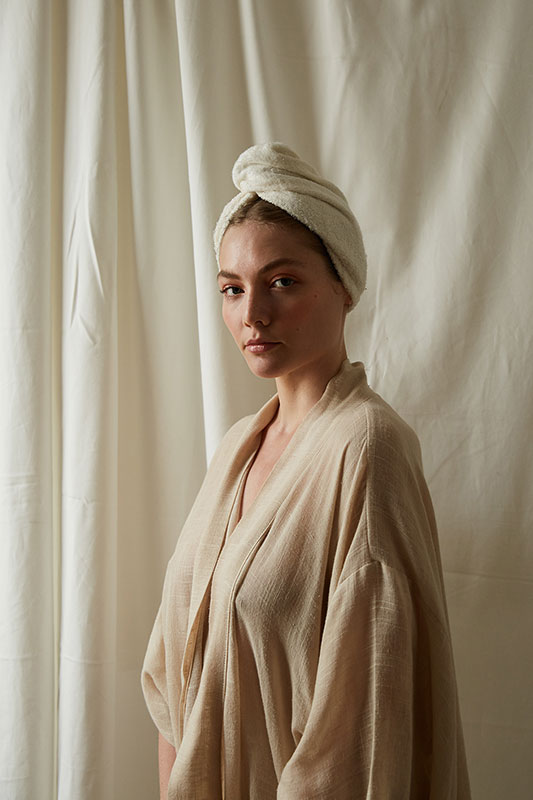 woman wearing bamboo hair towel